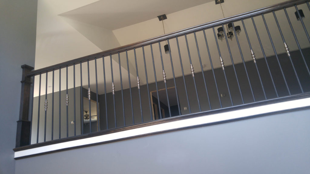 metal balusters and hand rail (Wood Stairs Canada)