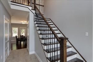 Craftsman newel post metal balusters and single left miter stair treads (Wood Stairs Canada)