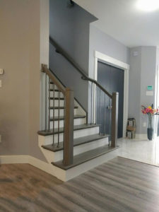 Modern profile hand rail and newel posts with metal balusters and a combination of our beuatiful straight end and double miter end stair treads
